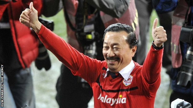 Cardiff City owner Vincent Tan sports the red shirt he introduced at the beginning of the season.